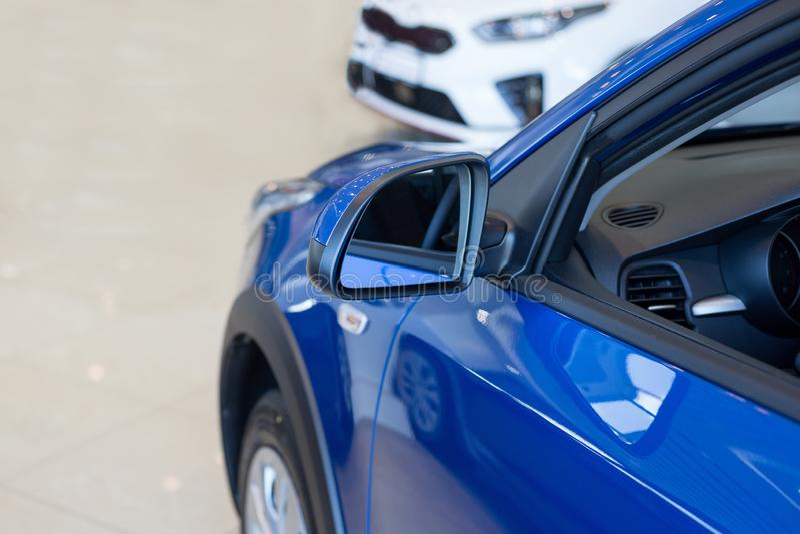 New cars at dealer showroom. Car auto dealership. Prestigious vehicles stock image