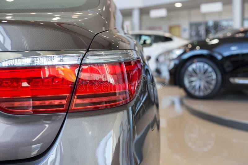 New cars at dealer showroom. Car auto dealership. Prestigious vehicles royalty free stock image