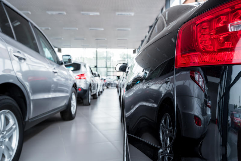 New cars at dealer showroom. Stock of cars in showroom of automobile dealer royalty free stock photos