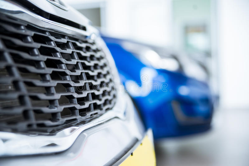 New cars at dealer showroom. Stock of cars in showroom of automobile dealer stock photos