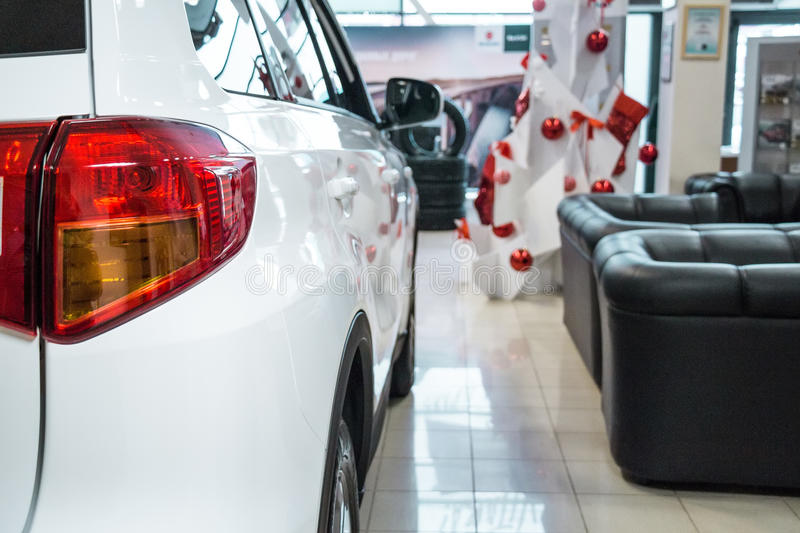 New cars at dealer showroom. Stock of cars in showroom of automobile dealer stock image
