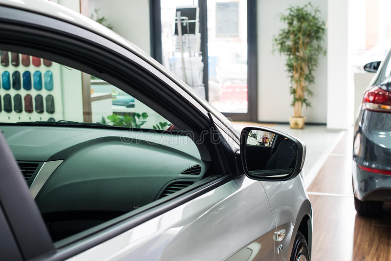 New cars at dealer showroom. Stock of cars in showroom of automobile dealer royalty free stock photography