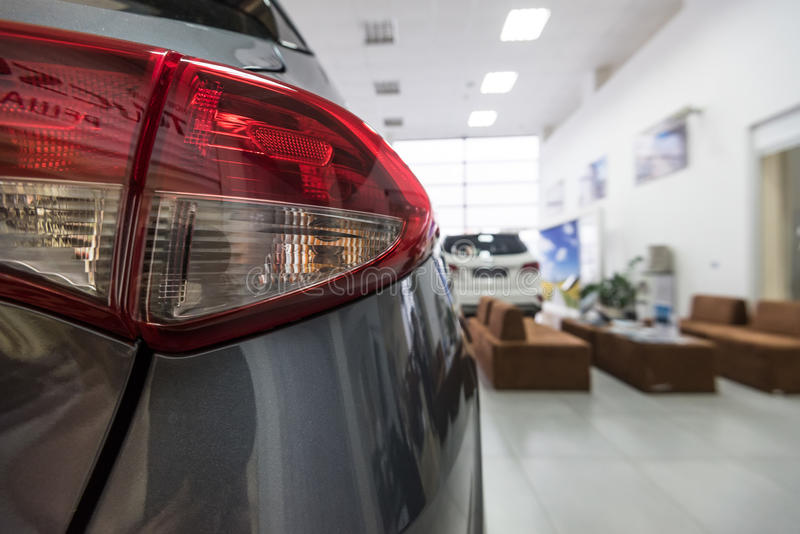 New cars at dealer showroom. Stock of cars in showroom of automobile dealer royalty free stock images