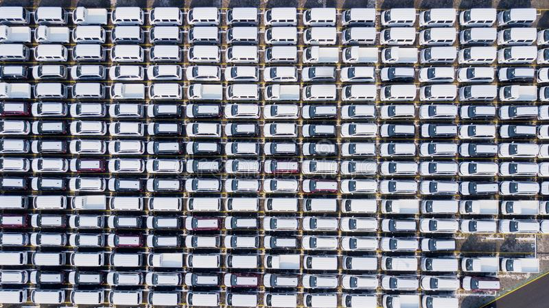 New cars parked at an automobile factory. Top view of new cars parked outside in the parking lot at an automobile factory for export royalty free stock image