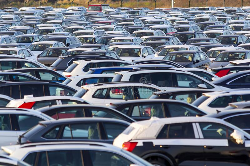 New cars for sale. Lots of new cars for sale in a parking stock images