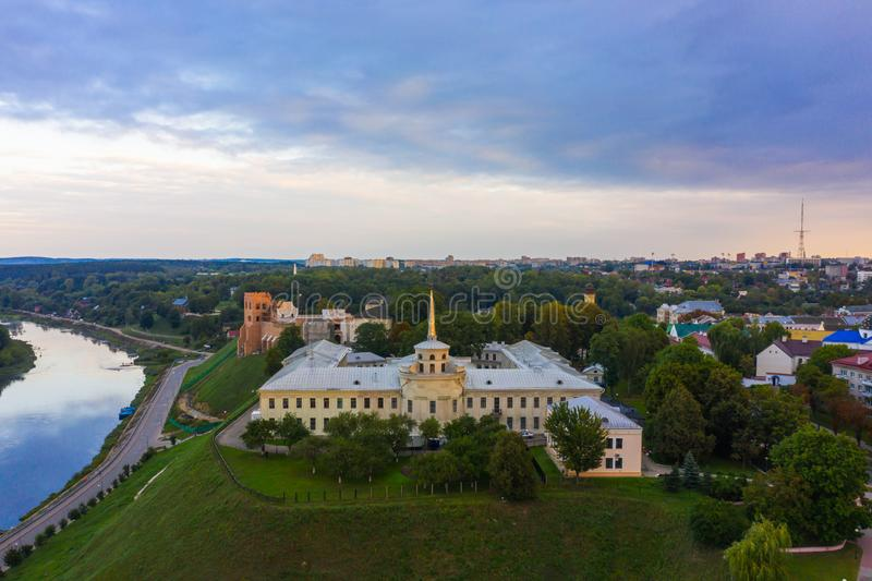 New Castle on high river bank of Neman in Grodno in sunset light, Aerial view from a drone., Belarus stock images