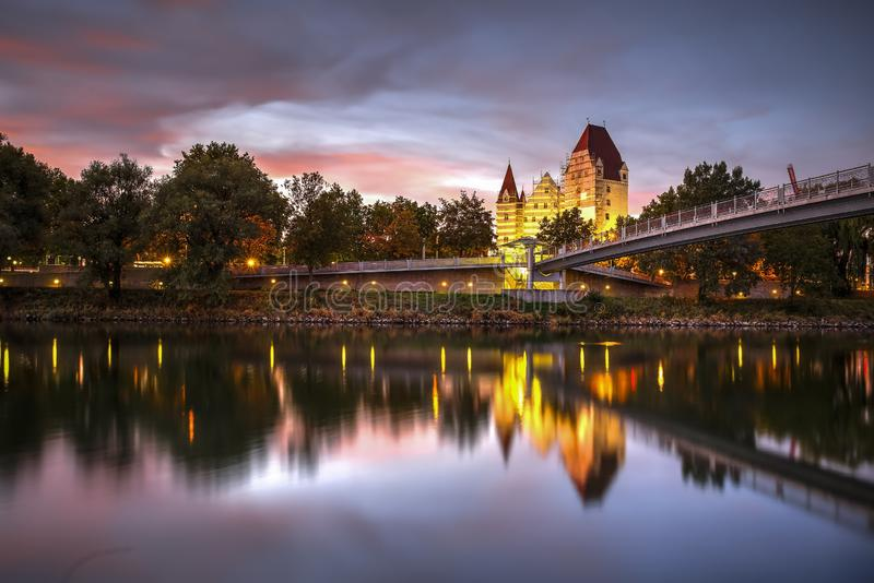 The New Castle, Ingolstadt, Germany. The Bavarian New Castle mirrored on Danube River during sunset, Ingolstadt, Germany. Photo taken on 26 September 2018 royalty free stock photography