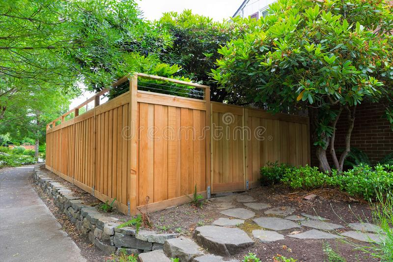 New Cedar Wood Fencing on Side Yard of house in suburb. New Cedar Wood Fence with gate door on home side yard landscaping royalty free stock photo