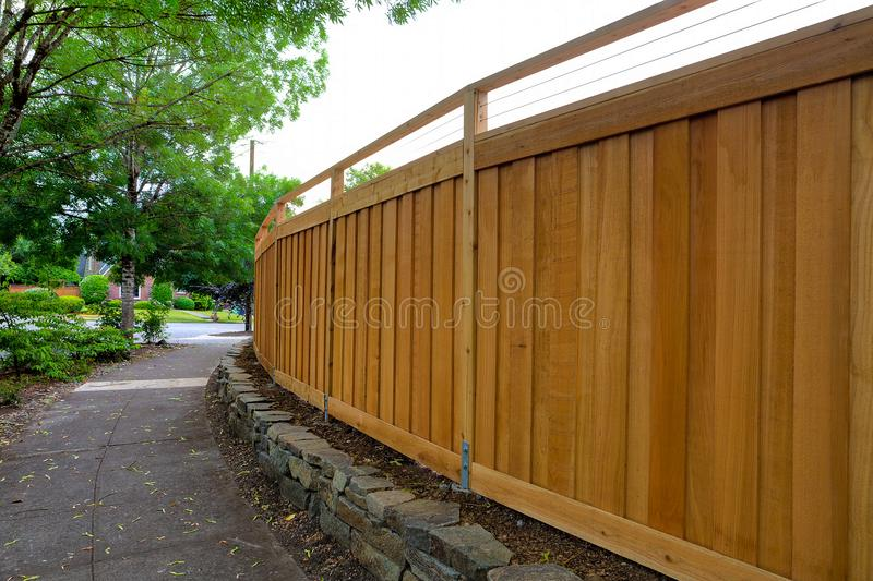 New Cedar Wood Fencing around Backyard around house. New Cedar Wood Fence around home backyard property landscaping stock image