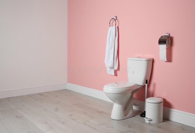 New ceramic toilet bowl in bathroom. New ceramic toilet bowl in modern bathroom stock photo