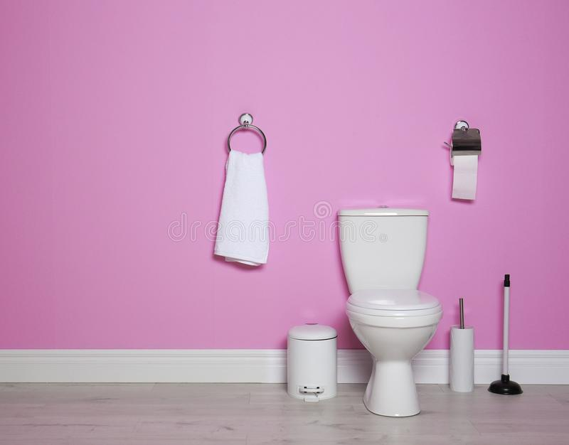 New ceramic toilet bowl in modern bathroom. With space for text royalty free stock image