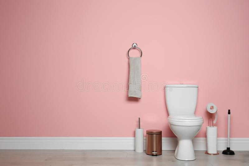New ceramic toilet bowl in modern bathroom. With space for text royalty free stock images