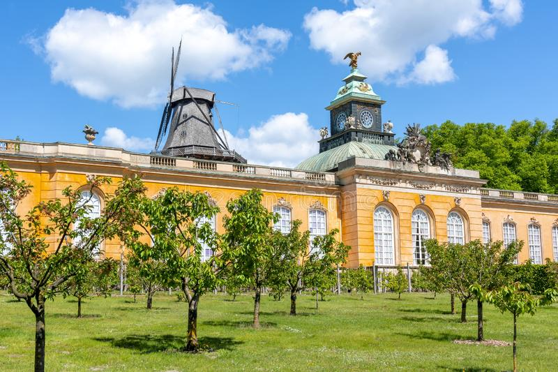 New Chambers Neue Kammern palace and Windmill Windmuhle in  Sanssouci park, Potsdam, Germany royalty free stock photo