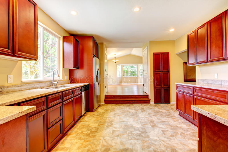 New cherry wood kitchen with stinless steal appliances. New large cherry wood kitchen with stinless steal appliances royalty free stock images