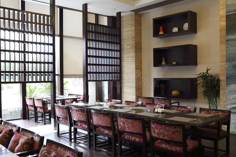 New Chinese style hotel lobby bar. Flocking chair, rows of the table royalty free stock photography
