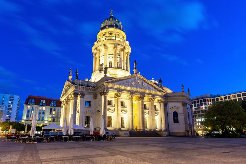 New Church Deutscher Dom or Neue Kirche on Gendarmenmarkt square at night, Berlin, Germany royalty free stock images