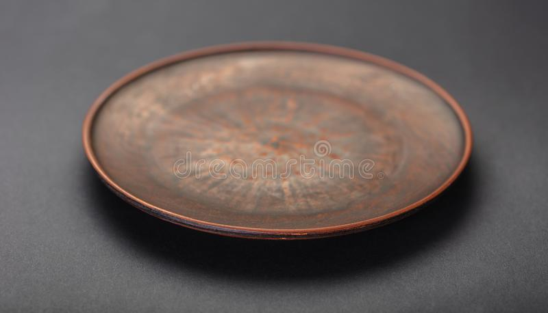 New clay plate closeup. On black background royalty free stock photos