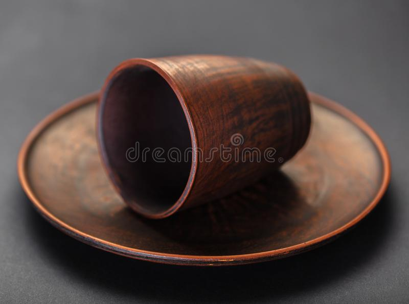 New clay plate and cup. On black background royalty free stock image