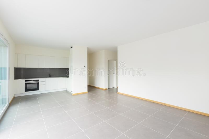 New, clean and empty kitchen in the empty room stock photography