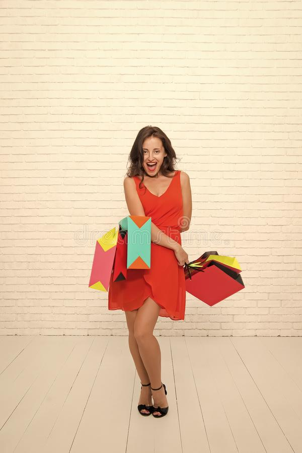 New clothes. happy woman go shopping. Fashion. Black Friday sales. Last preparations. big sale in shopping mall. Crazy. Girl with shopping bags. Happy shopping royalty free stock photography