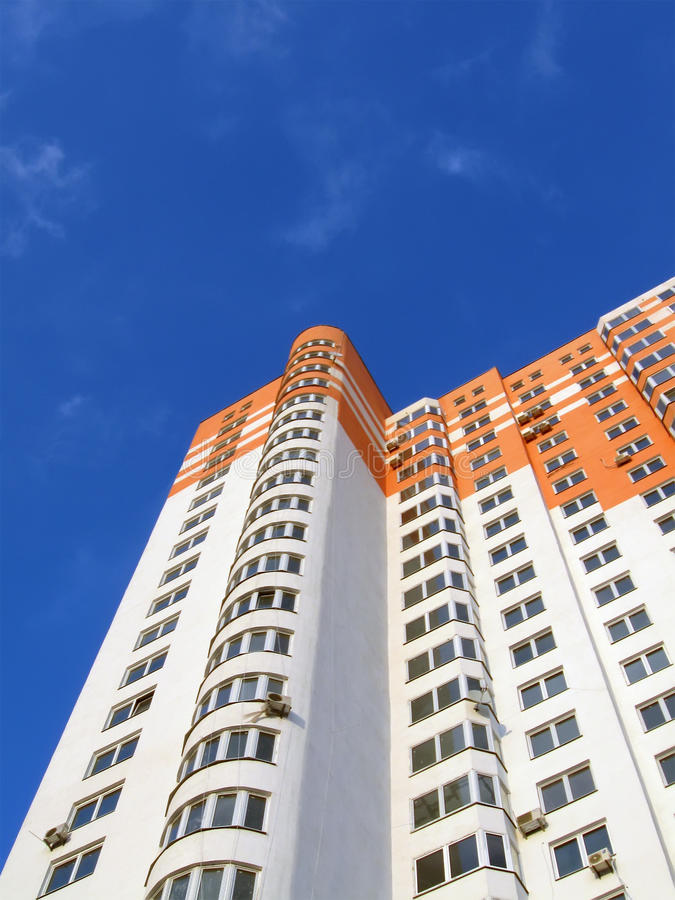 Download New Colorful Orange Building, Blue Sky, Clouds Stock Photo - Image: 13377102