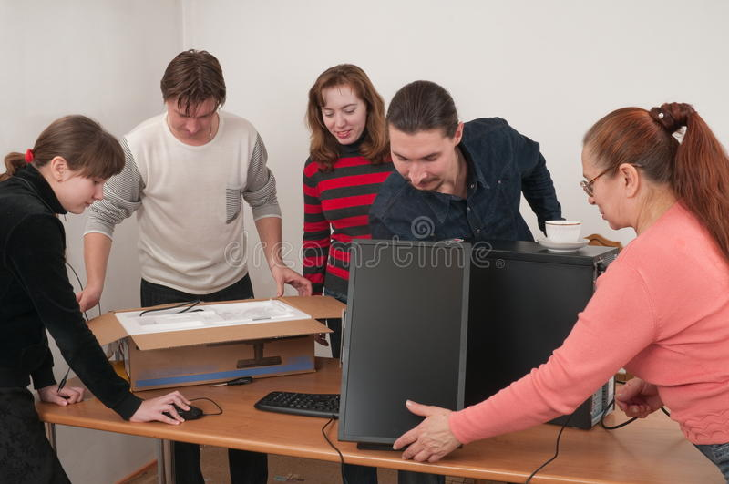 The New Computer And Family. Royalty Free Stock Photos