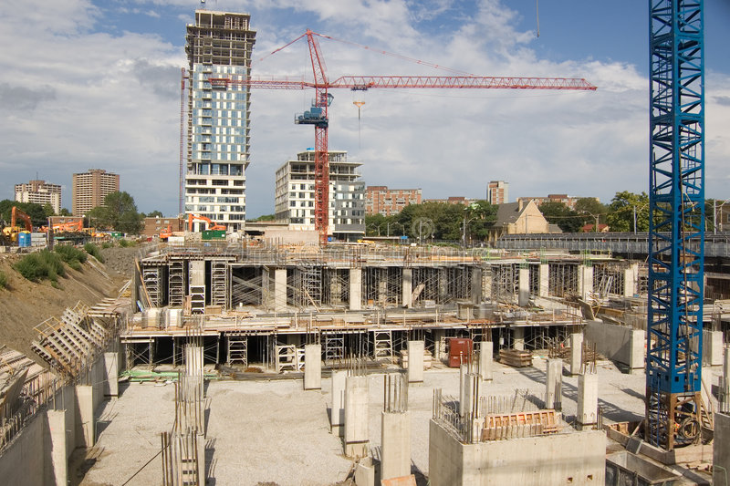 New constraction. Site. Crane, unfinished building, basement stock image