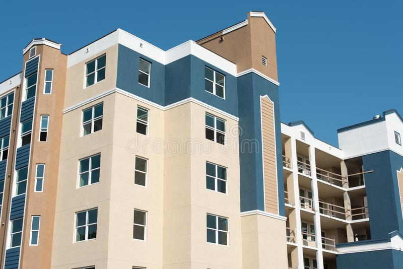 New construction of apartment homes or condominiums. Newly completed construction of apartment homes with fresh paint and Stucco. Building shows SOLD signs stock image