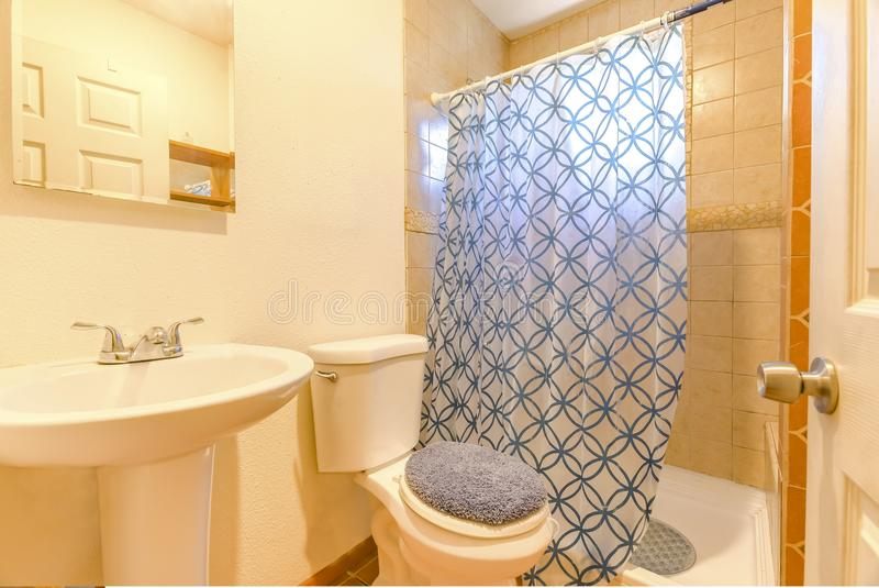 New construction modern home bathroom with curtain and shower stock photos