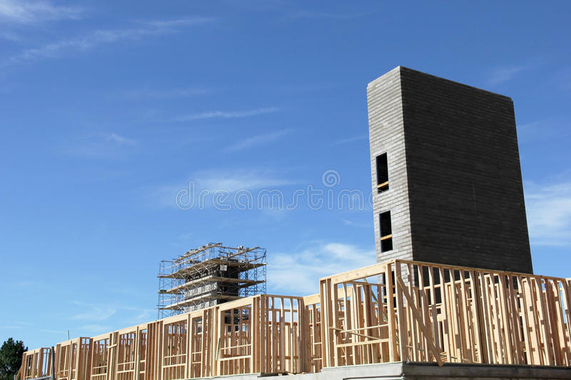 New Construction with two elevator shafts. New construction with first floor wood framing and two elevator shafts under construction stock photo