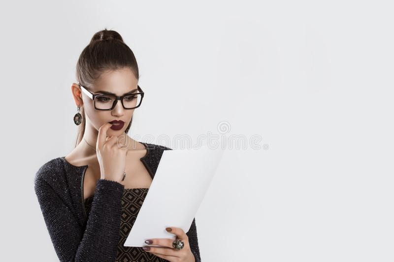 Worried girl business woman looking skeptical analyzing papers royalty free stock photography