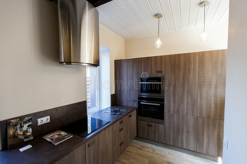 New beautiful brown kitchen in the new cottage stock images