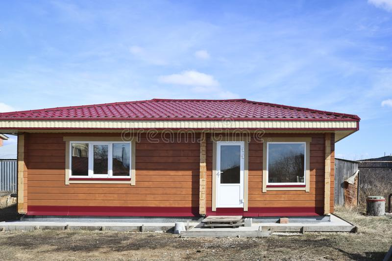 New country house, bathhouse. Completion of construction. Country wooden house royalty free stock image