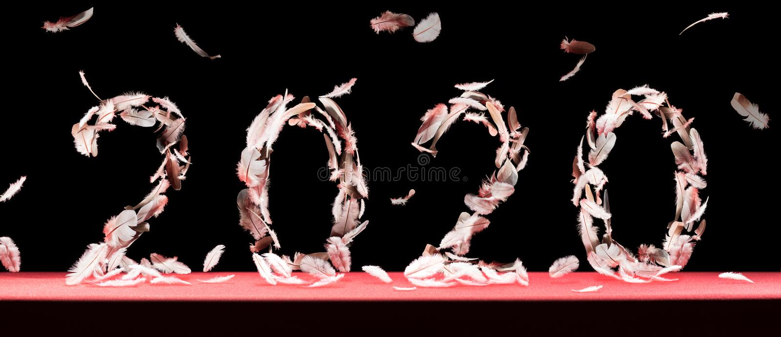 New 2020 year with falling feathers. stock photos