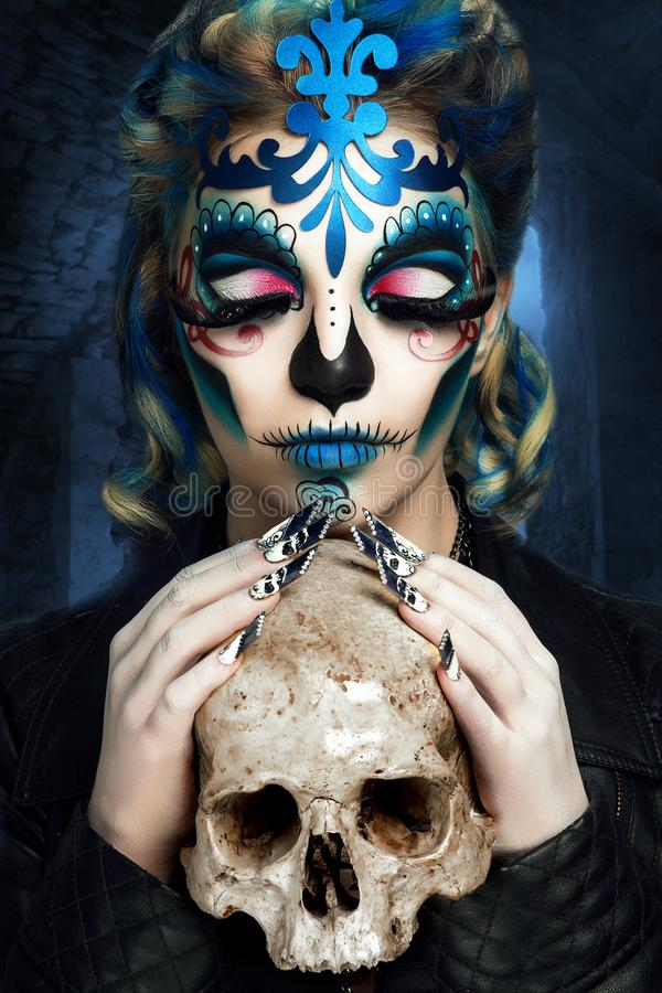 Blue art make up. New creative calavera is a representation of human skull. applied to decorative make up the Mexican celebration of the Day of the Dead Dia de royalty free stock photography