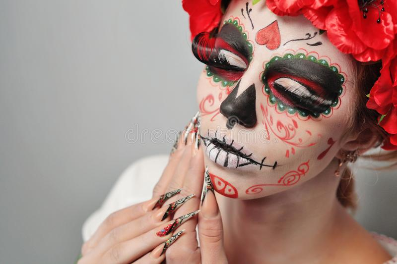 Hallloween art make up. New creative calavera is a representation of human skull. applied to decorative make up the Mexican celebration of the Day of the Dead royalty free stock photo