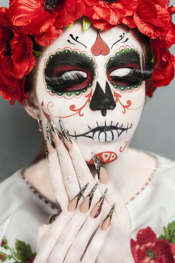 Hallloween art make up. New creative calavera is a representation of human skull. applied to decorative make up the Mexican celebration of the Day of the Dead stock photos