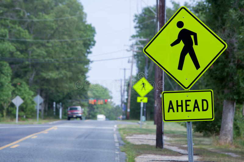 New Crosswalk Signs. In residental community stock photography