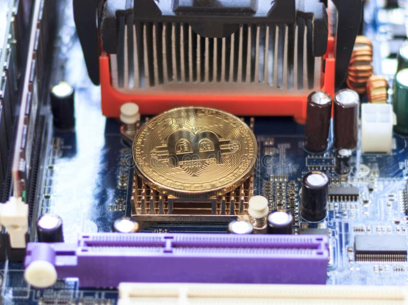 New crypto currency, bitcoin and computer motherboard, cooler stock photography