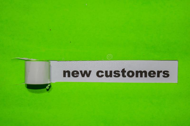 New Customers, Inspiration and business concept on green torn paper stock images