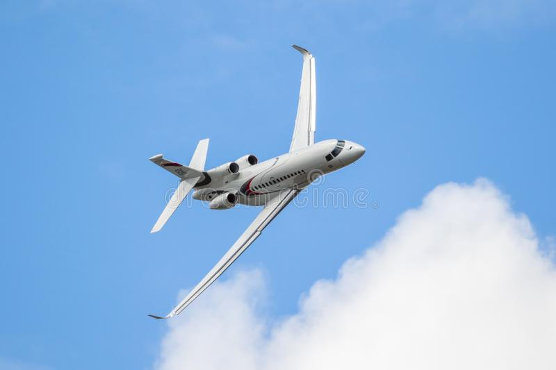 New Dassault Falcon 8X business jet. LE BOURGET PARIS - JUN 21, 2019: New Dassault Falcon 8X business jet performing at the Paris Air Show france white fly royalty free stock photography