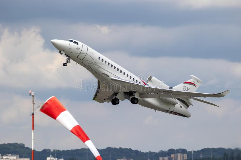 New Dassault Falcon 8X business jet plane. LE BOURGET PARIS - JUN 21, 2019: New Dassault Falcon 8X business jet plane taking off for a performance at the Paris royalty free stock images
