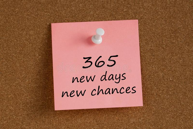 365 new days new chances written on remember note stock image