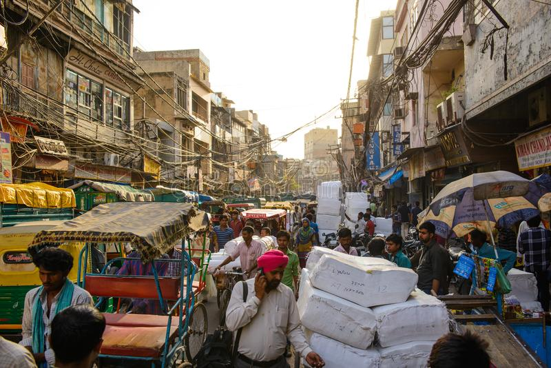 New Delhi, India - April 16, 2016 : Overcrowded street in old town with smog, dangerous electric lines and Jama masjid stock photography