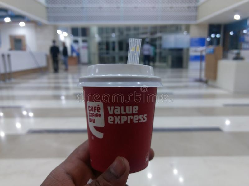 NEW DELHI, INDIA - March 25, 2019 : cafe coffee day coffee with little straw pipe in hand stock images