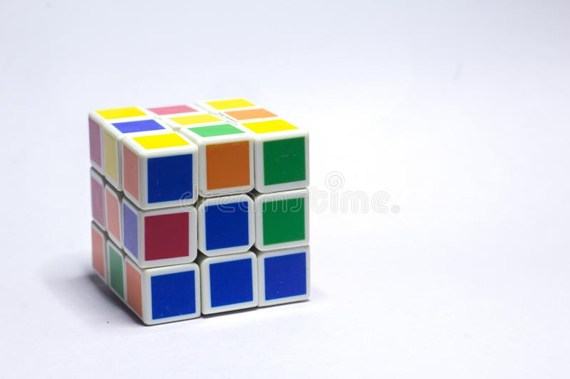 New Delhi, India - May 10, 2019. Rubik`s cube color blue, white, orange, green, yellow on white background with space for text. New Delhi, India May 10, 2019 royalty free stock photo