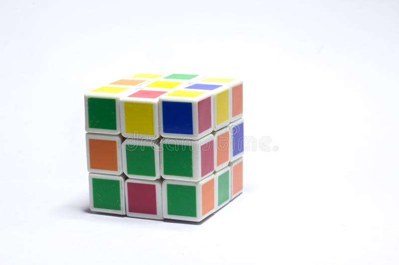 New Delhi, India - May 10, 2019. Rubik`s cube color blue, white, orange, green, yellow on white background with space for text. New Delhi, India May 10, 2019 stock image