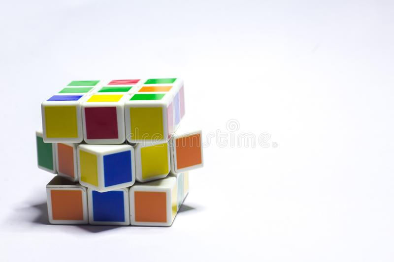 New Delhi, India - May 10, 2019. Rubik`s cube color blue, white, orange, green, yellow on white background with space for text royalty free stock photography