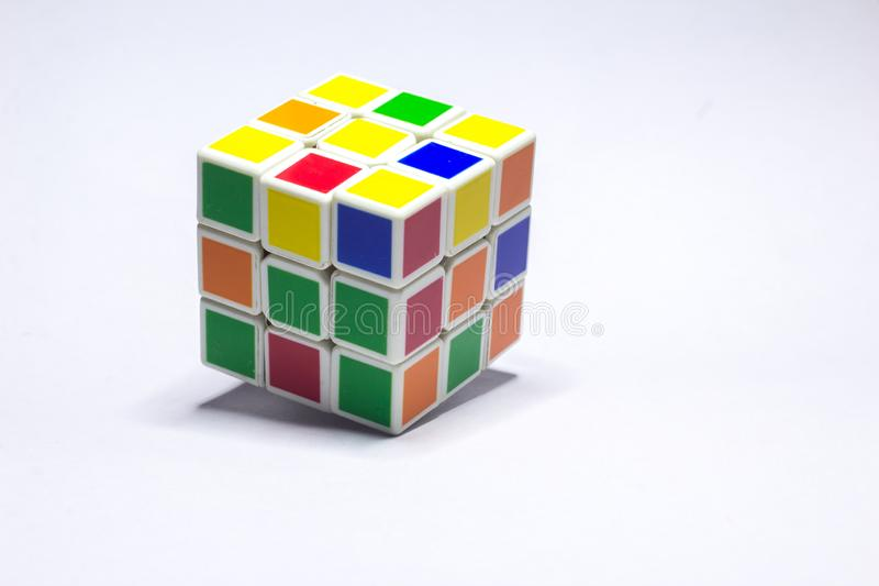 New Delhi, India - November 10, 2019. Rubik's cube on white background with space for text. New Delhi, India - May 10, 2019. Rubik's cube color blue royalty free stock images