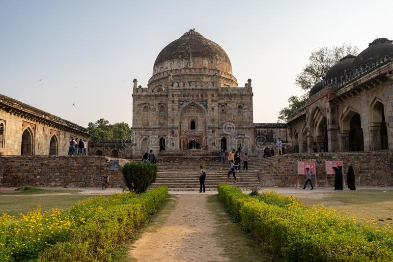 New Delhi, India - November 16, 2019: Tourists explore Bara Gumbad, a medieval monument located in Lodhi Gardens in Delhi, India. Tourists explore Bara Gumbad, a stock photos